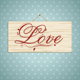 Love script on wood Royalty Free Stock Image