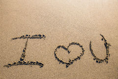 Love sculpted in the sand Royalty Free Stock Images