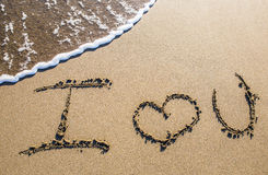 Love sculpted in the sand Royalty Free Stock Photos