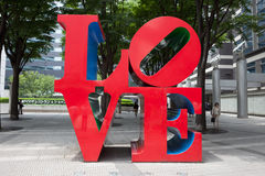 Love Sculpture in Japan. Love Sculpture in Shinjuku, Tokyo, Japan. It is designed by American artist Robert Indiana Stock Images