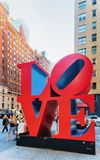 Love sculpture New York. New York, USA - May 06, 2015: Love sculpture by American artist Robert Indiana, New York. The famous monument is located on 6th Avenue stock image