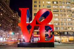 Love sculpture at night in New York. NEW YORK - February 10: Love sculpture at night on February 10, 2014 in New York. The famous monument by Robert Indiana is stock photography