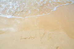 Love sea written on the beach. Royalty Free Stock Images