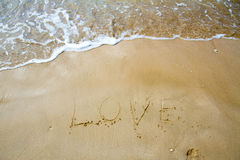 Love sea written on the beach. Stock Images