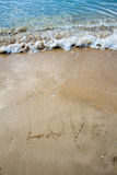 Love sea written on the beach. Royalty Free Stock Photography