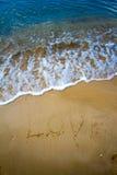 Love sea written on the beach. Stock Photo