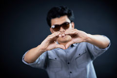 Love shape hand by Handsome man Royalty Free Stock Photos