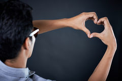 Love shape hand by Handsome man Stock Photos