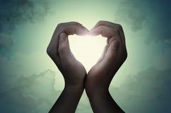 Love shape hand silhouette Royalty Free Stock Photos