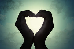 Love shape hand silhouette Royalty Free Stock Image