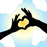 Love shape hand silhouette Stock Photo
