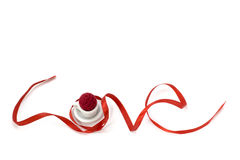 Love shape ribbon art with miniature cup Royalty Free Stock Photo