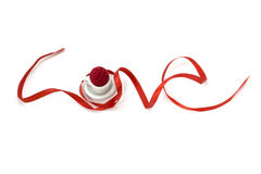 Love shape ribbon art with miniature cup Royalty Free Stock Photography