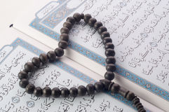 Love shape Tasbih (beads) on Holy Quran Royalty Free Stock Photography