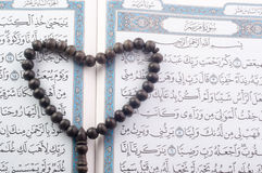 Love shape Tasbih (beads) on Holy Quran Stock Photography