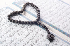 Love shape Tasbih (beads) on Holy Quran Stock Photo