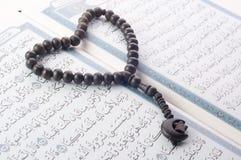 Love shape Tasbih (beads) on Holy Quran Stock Photo