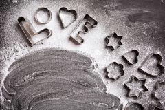 Free Love Shaped Cookie Cutters And Flour On Black Royalty Free Stock Photo - 65020275