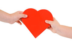 Love and sharing. Sharing love concept - kids hands with red heart - isolated Royalty Free Stock Image
