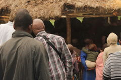 The love of sharing. Villagers awaiting for there gift Royalty Free Stock Image