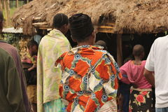 The love of sharing. Villagers looking at clothing that is given to them Royalty Free Stock Images