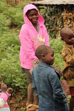 The love of sharing. Villagers looking at clothing that is given to them Stock Photo