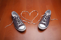 Love of Shoes. Canvas shoes on the wooden background royalty free stock photo