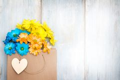 Love shopping abstract background with paper bag and spring flowers Stock Photography