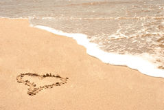 Love sign on the beach Stock Photos