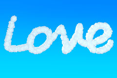 Love Sign from clouds. In the blue sky Royalty Free Stock Photo