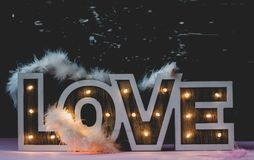Love sign on dark background royalty free stock photos