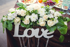 Love sign and flowers on Banquet table Stock Photos