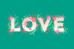 Love sign with flowers. Love sign with flower decoration, green background Royalty Free Stock Photo