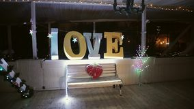 Love sign and heart of flowers. At night stock video footage
