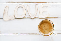 LOVE sign letters with espresso coffee Royalty Free Stock Photos