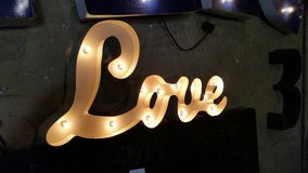 Love sign lit up and waiting for LOVE Royalty Free Stock Photo