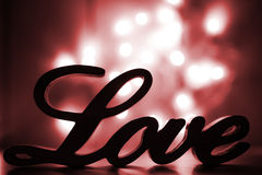 Love sign with red sparkle Stock Photos