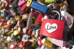 Love sign and romance concept. Heart shaped, love padlocks locked at landmark, tourists place. Many love padlocks locked on iron chain at landmark, tourists Royalty Free Stock Photos