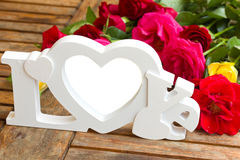 Love sign with roses Royalty Free Stock Images