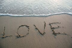 Love sign on sandy beach