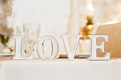 Love sign on table. Decor in restaurant. Light beige Royalty Free Stock Photo