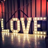 Love Sign Word Lighting Bulbs Against Barn Wall Stock Photos