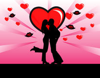 Love. Silhouette of a loving couple, kiss and heart background Stock Photography