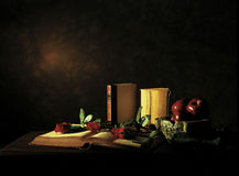 Love, sin & colture. Three book, roses and apples Stock Photo