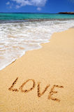 Love sing on the beach. Love in the sand on the beach Stock Photo