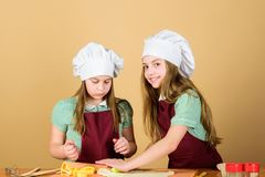 Love the smell of bread baking. Little girls baking home made pastry. Small children using flour and baking form on stock photos