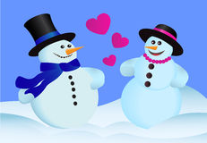 Love snowmen. Two heterosexual lovers snowman standing in the snow Stock Photo