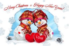 Love snowmen. Snowfall. Love concept. Greeting card Merry Christmas and happy new year. Love snowmen. Snowfall. Snow background. Love concept. Merry Christmas Stock Photography