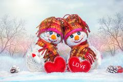 Love snowmen. Snowfall. Love concept. Valentine`s Day Greeting card stock photography