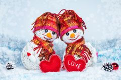 Love snowmen. Snowfall. Love concept. Greeting card Happy Valentines day royalty free stock photo